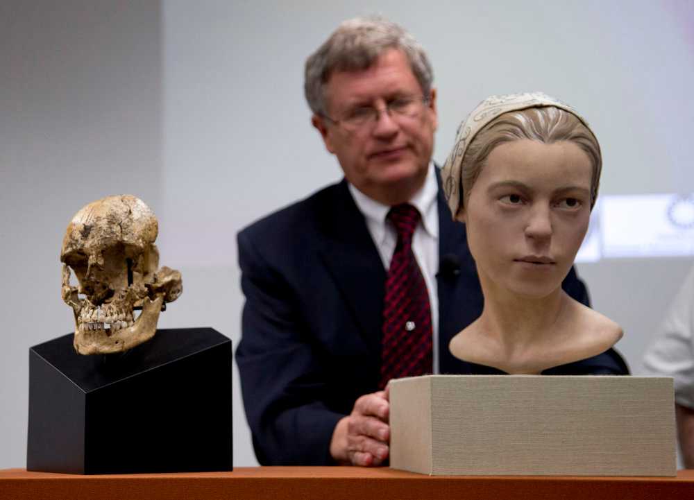 """. Doug Owsley, division head for Physical Anthropology at the Smithsonian\'s National Museum of Natural History, displays the skull and facial reconstruction of  \""""Jane of Jamestown\""""  during a news conference at the museum in Washington, Wednesday, May 1, 2013. Scientists announced during the news conference that they have found the first solid archaeological evidence that some of the earliest American colonists at Jamestown, Va., survived harsh conditions by turning to cannibalism presenting the discovery of the bones of a 14-year-old girl, \""""Jane\"""" that show clear signs that she was cannibalized. (AP Photo/Carolyn Kaster)"""