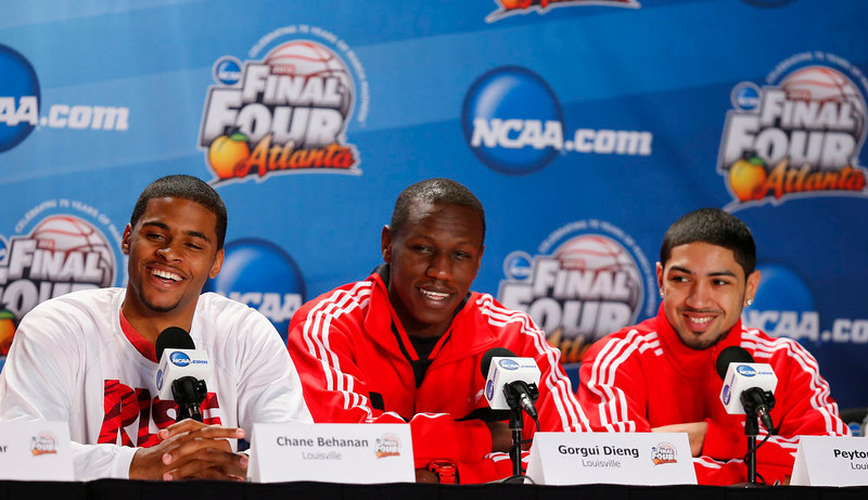 . Louisville Cardinals\' Chane Behanan, Gorgui Dieng and Peyton Siva take part in a news conference ahead of the NCAA men\'s Final Four basketball championship in Atlanta, Georgia April 7, 2013.   REUTERS/Chris Keane
