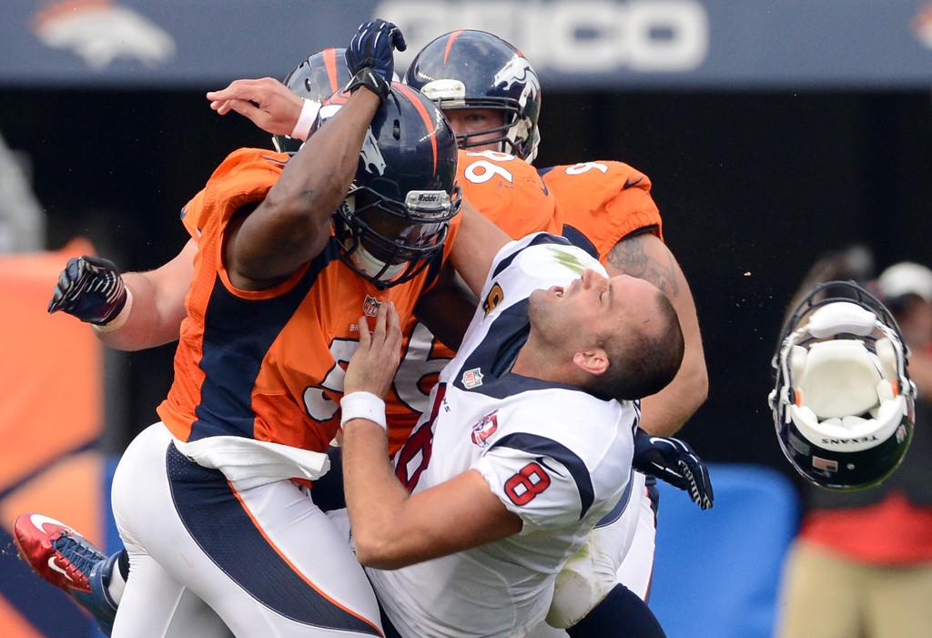 . Denver Broncos middle linebacker Joe Mays knocks Houston Texans\' Quarterback Matt Schaub\'s helmet off during the third quarter of play at Sports Authority Field at Mile High in Denver, CO on Sunday, September 23, 2012.  Joe Amon/The Denver Post