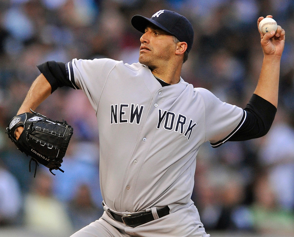 . New York Yankees starter Andy Pettitte delivers a pitch during the first inning of a baseball game against the Chicago White Sox in Chicago, Monday, Aug. 5, 2013. (AP Photo/Paul Beaty)