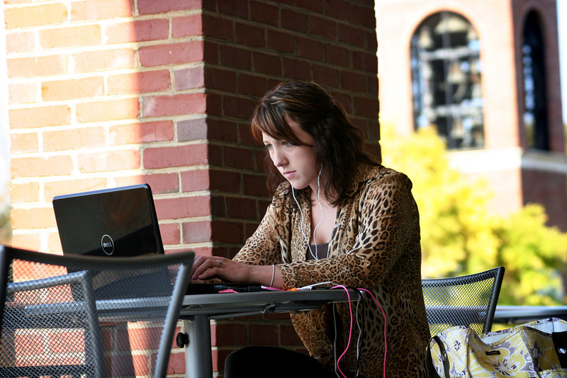 A Gardner-Webb University student studies on the Lakeside Terrace of the Tucker Student Center on a Fall day.