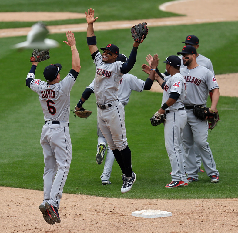 . Cleveland Indians\' Brandon Guyer (6) and Francisco Lindor celebrate the team\'s 5-2 win over the Chicago White Sox after a baseball game Thursday, June 14, 2018, in Chicago . (AP Photo/Annie Rice)