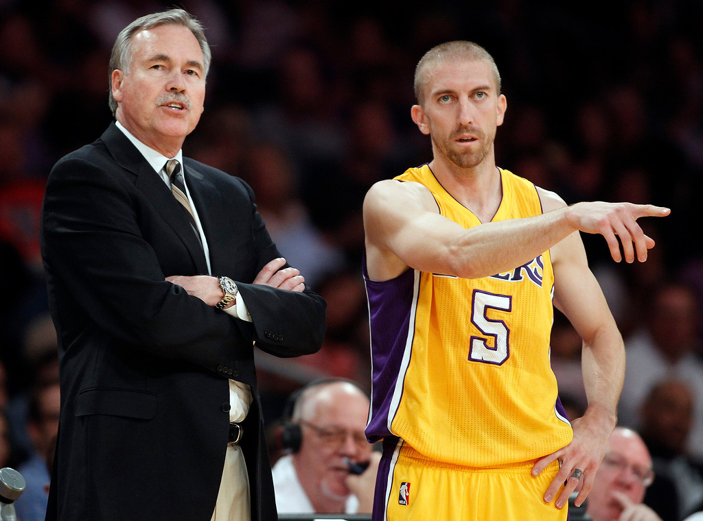 . Los Angeles Lakers head coach Mike D\'Antoni, left, listens to Lakers guard Steve Blake in the second quarter during an NBA preseason basketball game against the Denver Nuggets, Sunday, Oct. 6, 2013 in Los Angeles.  (AP Photo/Alex Gallardo)