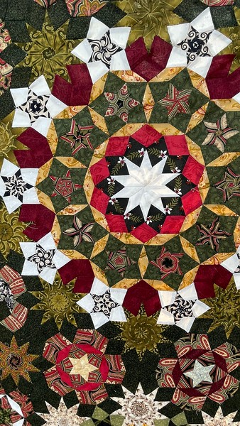 Quilt by Kelly Sattler.  All hand pieced.