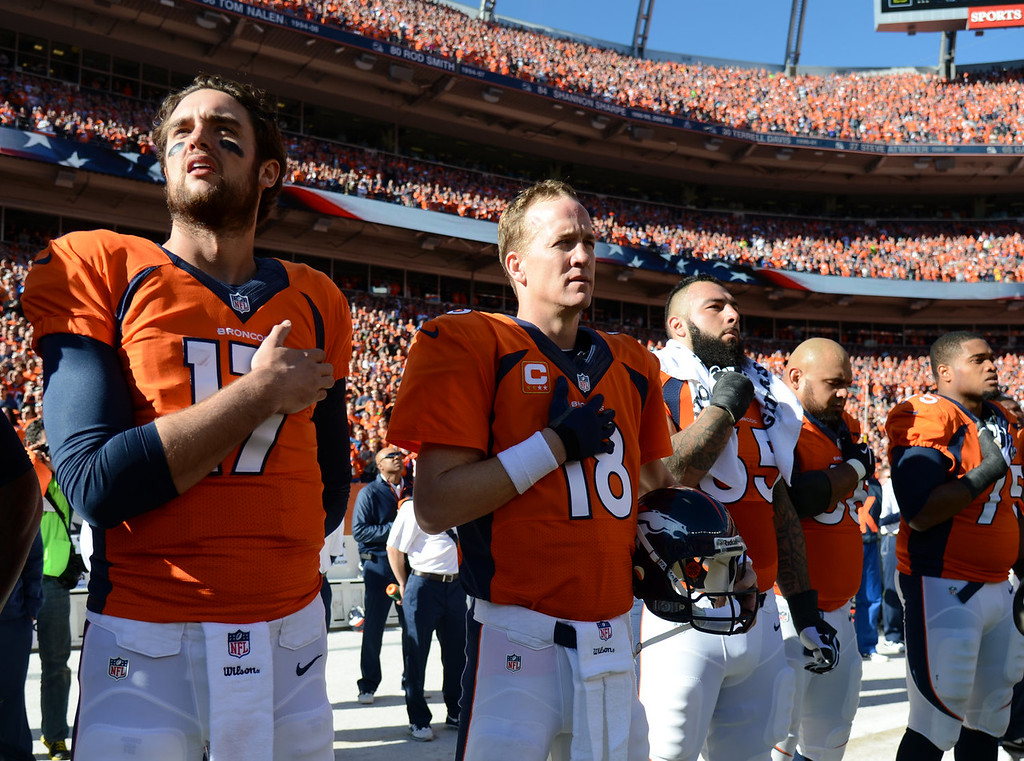 . Denver Broncos quarterback Peyton Manning (18) hand on heart at the start of the game. The Denver Broncos vs. The New England Patriots in an AFC Championship game  at Sports Authority Field at Mile High in Denver on January 19, 2014. (Photo by John Leyba/The Denver Post)