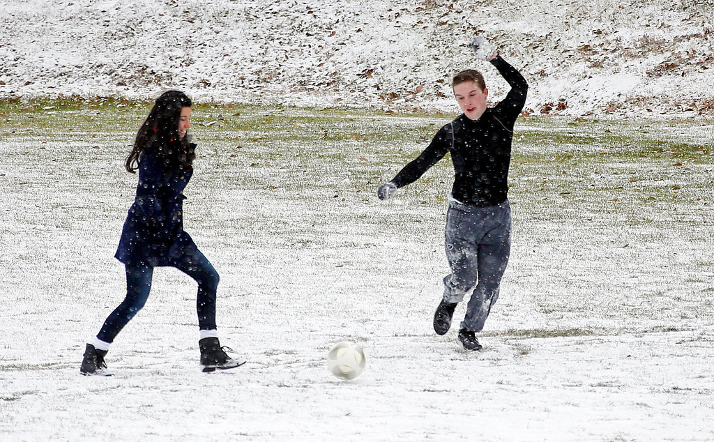. Belhaven University students Melissa Rey, left, and James Lewellan take advantage of the snow to play soccer on campus Tuesday, Jan. 28, 2014, on the Jackson, Miss., campus. An arctic blast spread across Mississippi with below freezing temperatures and treacherous driving conditions. (AP Photo/Rogelio V. Solis)