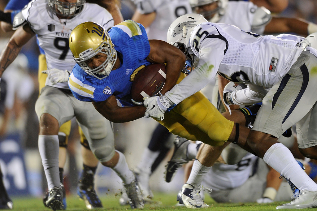 . UCLA RB Jordon James quarter dives for yardage against Nevada in the second quarter, Saturday, August 31, 2013, at the Rose Bowl. (Michael Owen Baker/L.A. Daily News)