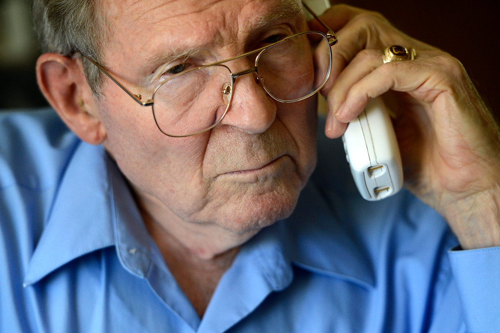 ". AURORA, CO. - May 22: Bob Crowell in his Aurora home listens as Governor John Hickenlooper on a conference call with other family members of Nathan Dunlap\'s crimes announces he granted the death row inmate a ""temporary reprieve\"" from the death penalty May 22, 2013 Aurora, Colorado. (Photo By Joe Amon/The Denver Post)"