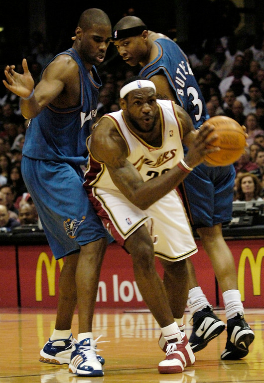 . Michael Blair/MBlair@News-Herald.com LeBron James is fouled by Caron Butler, right as he tries to work by Antawn Jamison, left during the first period.