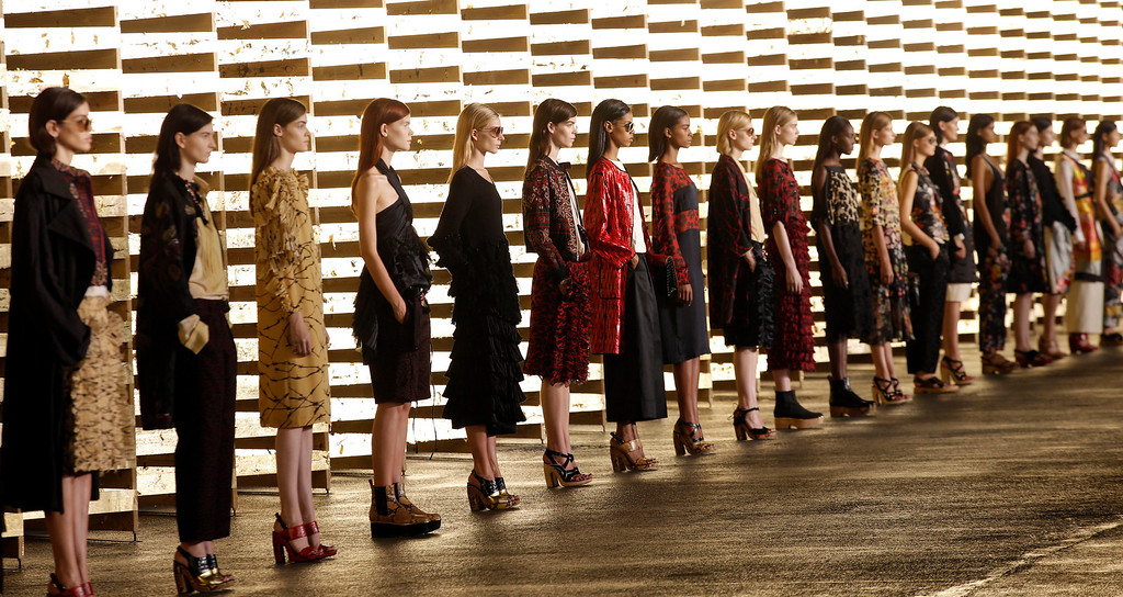 . Models wear creations for Belgian fashion house Dries van Noten\'s ready-to-wear Spring/Summer 2014 fashion collection, presented in Paris, Wednesday, Sept.25, 2013. (AP Photo/Christophe Ena)