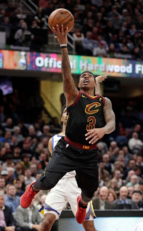 . Cleveland Cavaliers\' Isaiah Thomas drives to the basket against the Golden State Warriors in the first half of an NBA basketball game, Monday, Jan. 15, 2018, in Cleveland. (AP Photo/Tony Dejak)