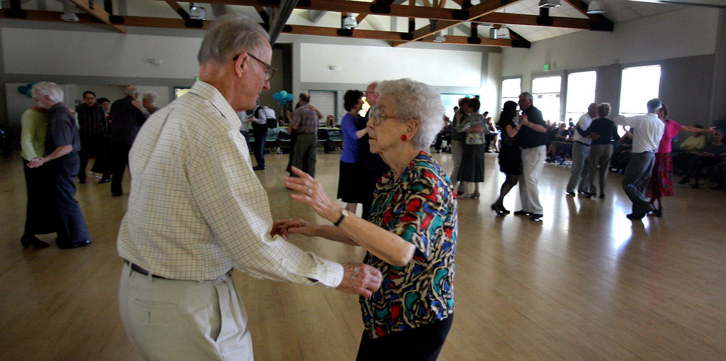 . Livermore residents, Bille Andersen, left and Betty Beebe dance to the sounds of The Cool Tones at the Pleasanton Senior Center\'s 20th anniversary celebration tea dance in Pleasanton, Calif. on Sunday, March 3, 2013.  (Jim Stevens/Staff)