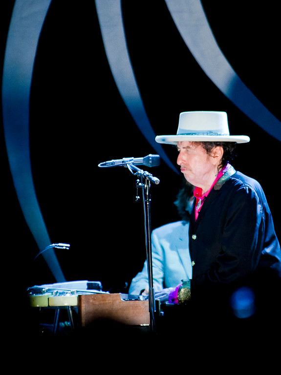 ". U.S. musician Bob Dylan performs with his band  in Ho Chi Minh City, Vietnam, Sunday, April 10, 2011.  After nearly five decades of singing about a war that continues to haunt a generation of Americans, legendary performer Bob Dylan finally got his chance to see Vietnam at peace.  Dylan took to the stage in the former Saigon on Sunday, singing such favorites as ""A Hard Rain\'s a-Gonna Fall\"" and \""Highway 61 Revisited.\""     (AP Photo/Le Quang Nhat)"