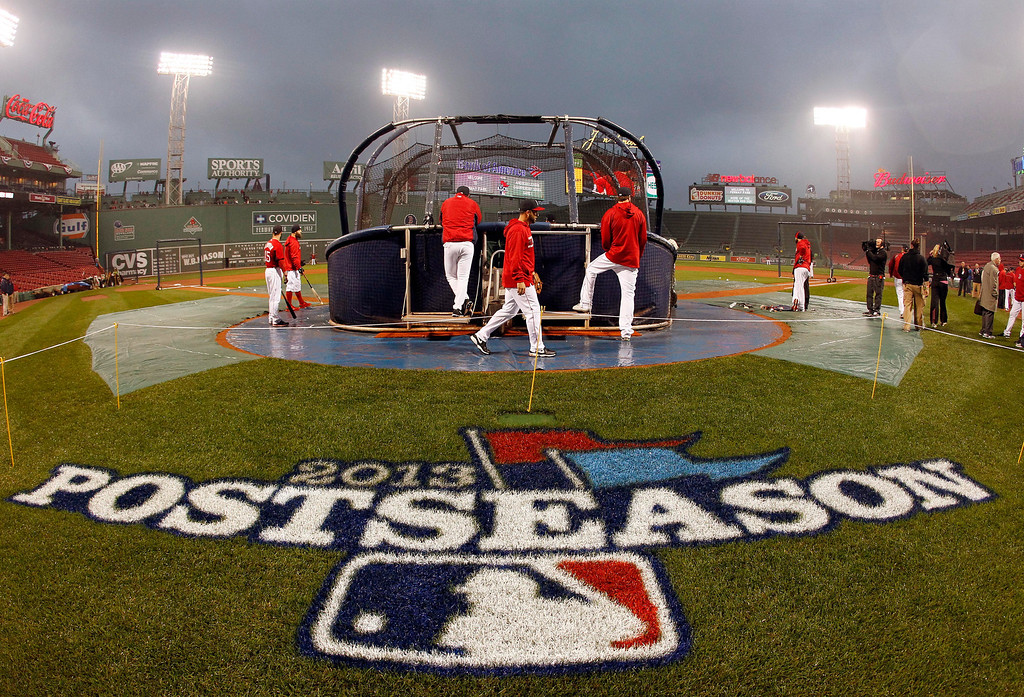 . Boston Red Sox players take batting practice before the start of  Game 1 of the American League baseball championship series against the Detroit Tigers Saturday, Oct. 12, 2013, in Boston. (AP Photo/Elise Amendola)