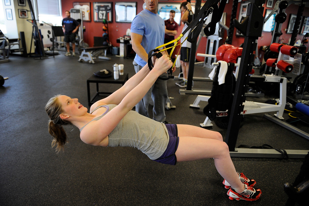. Missy Franklin goes through a vigorous workout with Loren Landow Monday, April 16, 2012 at Steadman Hawkins Clinic in Denver.  John Leyba, The Denver Post
