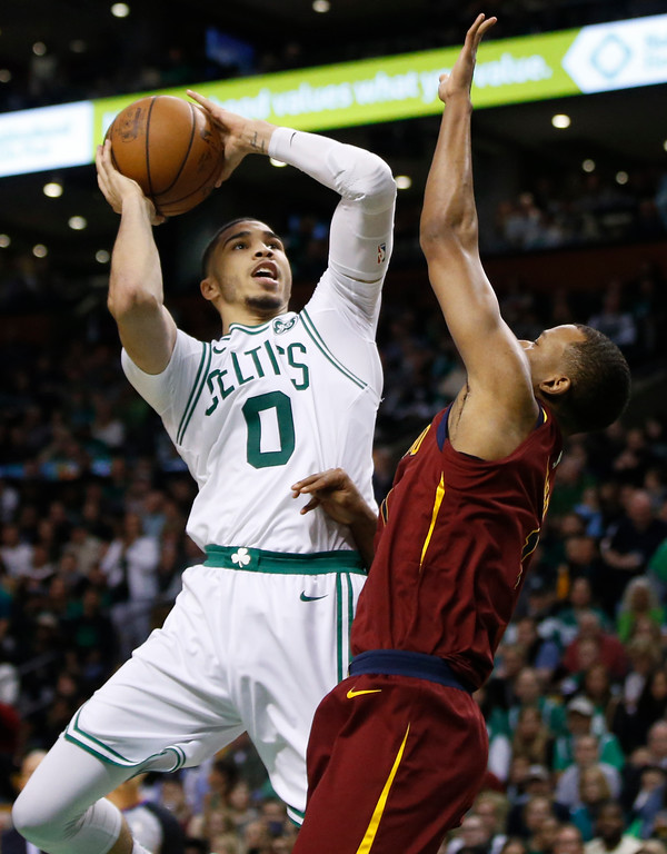 . Boston Celtics forward Jayson Tatum (0) goes to the hoop against Cleveland Cavaliers guard Rodney Hood during the second half of Game 1 of the NBA basketball Eastern Conference Finals, Sunday, May 13, 2018, in Boston. (AP Photo/Michael Dwyer)