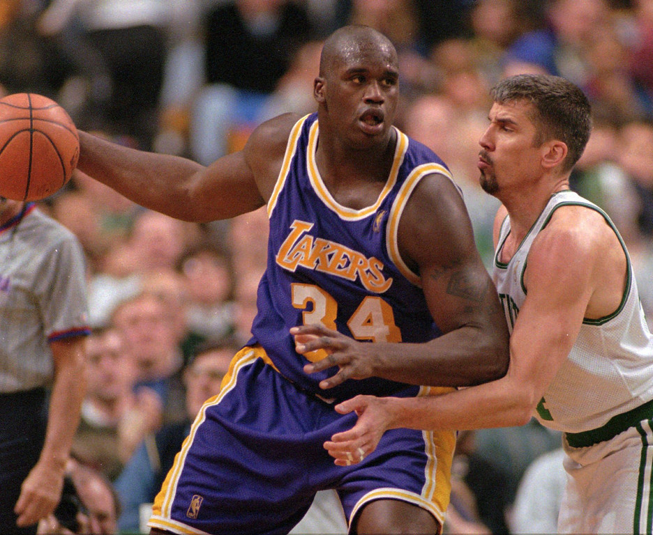 . Boston Celtics forward Frank Brickowski, left, puts some pressure on Los Angeles Lakers center Shaquille O\'Neal in the fourth quarter of their game in Boston, Wednesday, Nov. 27, 1996.  The Celtics defeated the Lakers 110-94. (AP Photo/Jim Rogash)