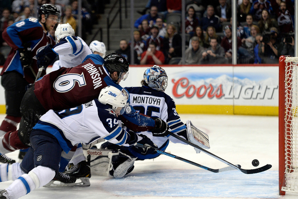 . Erik Johnson (6) of the Colorado Avalanche nearly gets a shot to go as Al Montoya (35) of the Winnipeg Jets and Tobias Enstrom (39) defend during the Avs\' 3-2 win. (Photo by AAron Ontiveroz/The Denver Post)