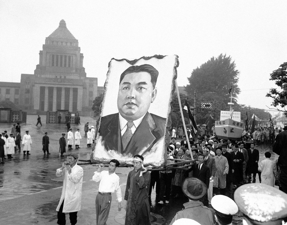 . North Korean demonstrators carry portrait of that countryís Communist Prime Minister, Kim Il Sung, during May Day festivities in Japan, May 2, 1959. In background is the Japanese National Diet (parliament) building in Tokyo. (AP Photo)