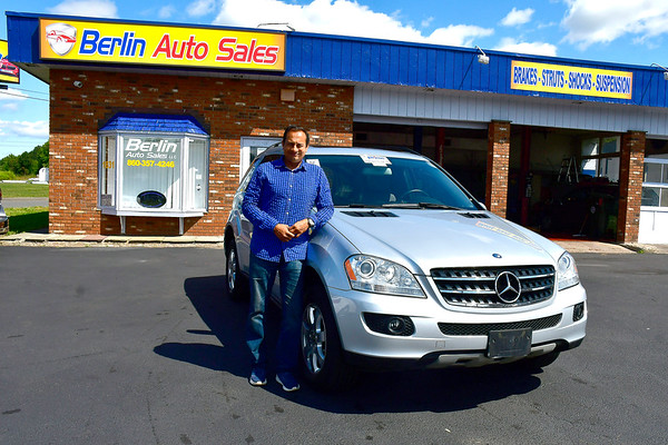 9/7/2019 Mike Orazzi | StaffrSyed Aurangzeb, owner of Berlin Auto Sales, LLC, during his grand opening on Saturday at 1631 Berlin Turnpike. He offers used car sales and service 6 days a week.
