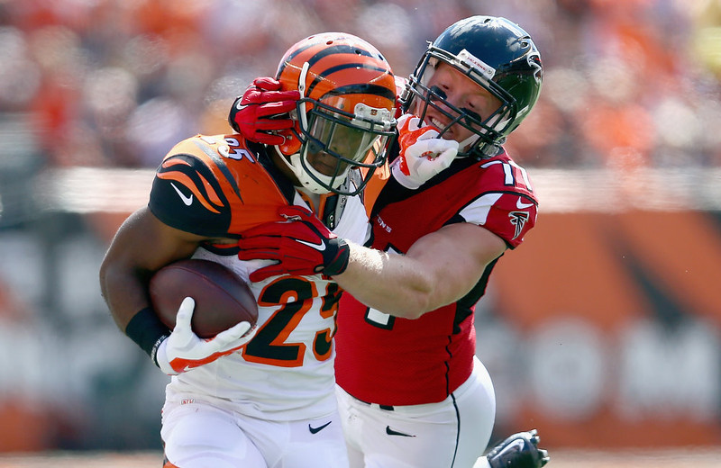 . Kroy Biermann #71 of the Atlanta Falcons tackles Giovani Bernard #25 of the Cincinnati Bengals during the first quarter at Paul Brown Stadium on September 14, 2014 in Cincinnati, Ohio.  (Photo by Andy Lyons/Getty Images)