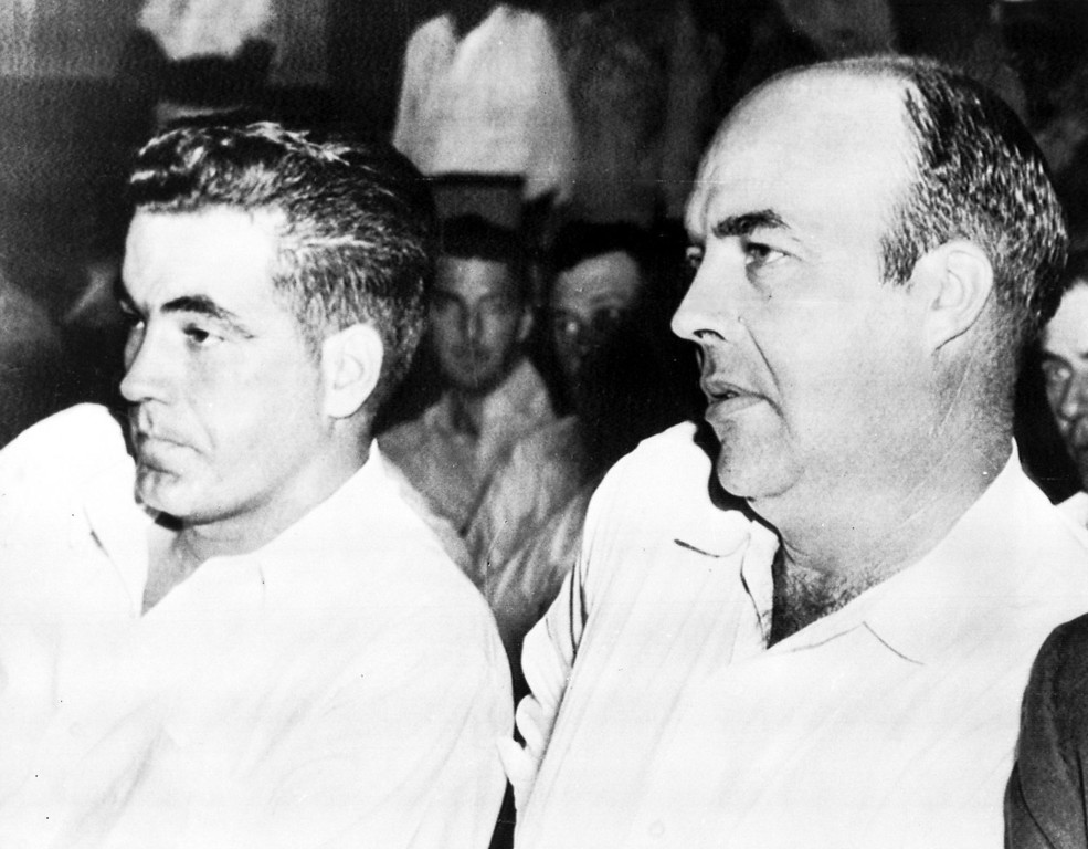 ". Inside the court during the murder trial against half-brothers Roy Bryant, left, and John W. Milam, in Sumner, Miss., Sept. 23, 1955. Bryant and Milam are charged with the murder of 14-year-old African American Emmett  L.Till from Chicago, who is alleged to have ""wolf-whistled\"" and made advances at Bryant\'s wife Carolyn.  (AP Photo)"