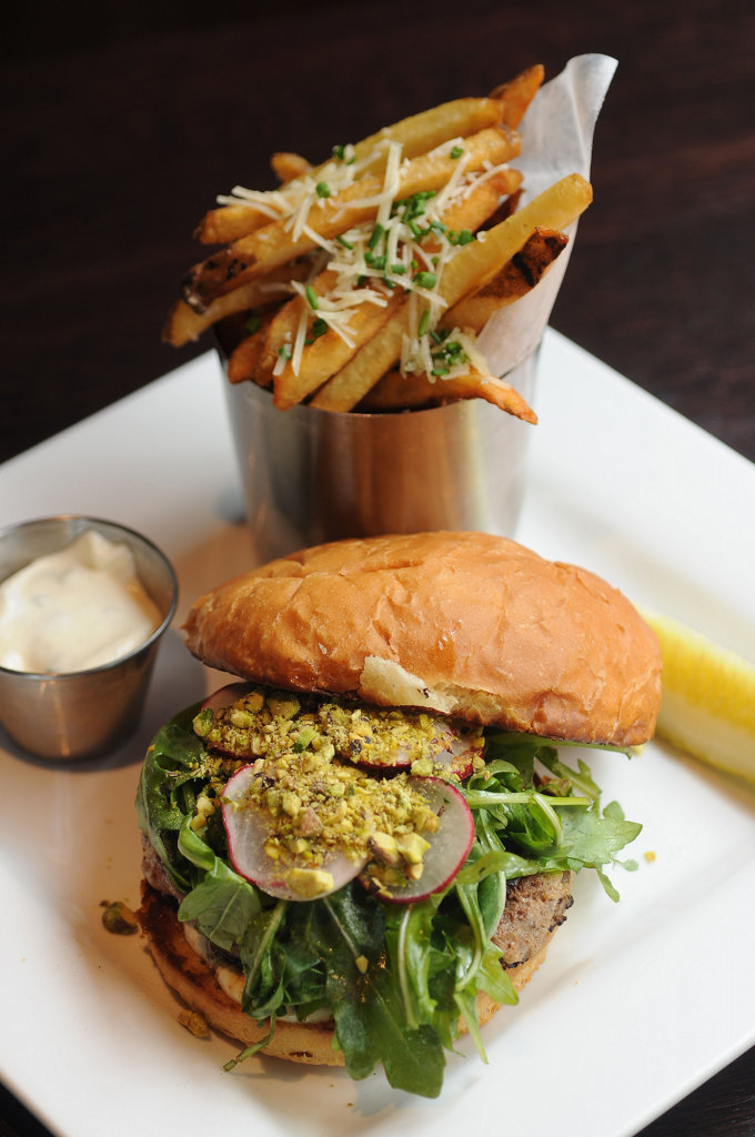 . Red Cow\'s Turkey Burger is topped with cilantro-lime aioli, sliced radish, arugula and crushed pistachios. Here, hand-cut truffle-parmesan fries are served on the side.  (Pioneer Press: Scott Takushi)