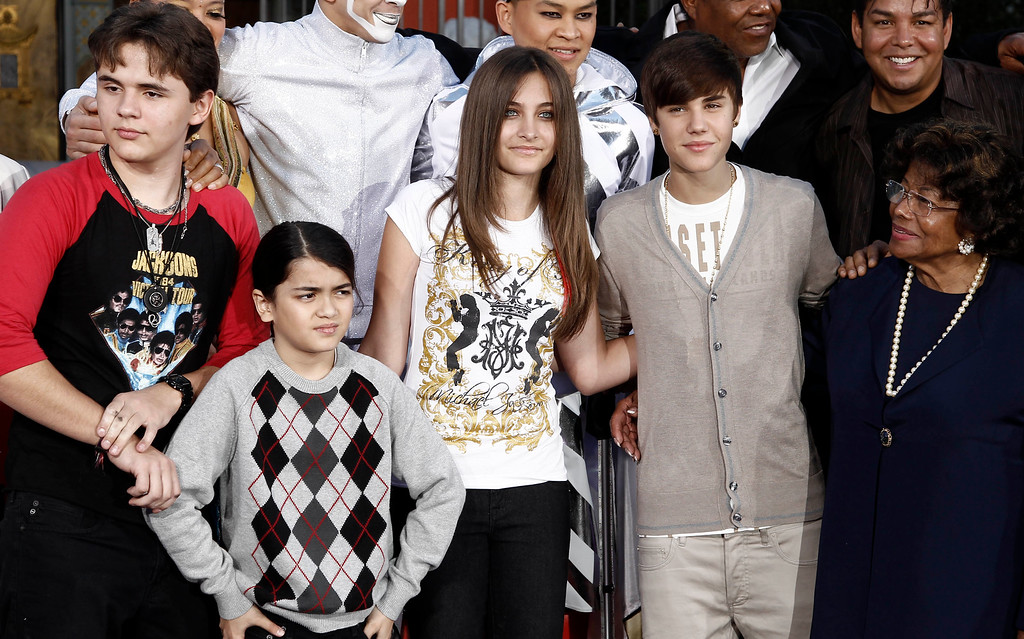 ". From left, Prince Jackson, Blanket Jackson, Paris Jackson, Justin Bieber, and Katherine Jackson pose together after the hand and footprint ceremony honoring musician Michael Jackson in front of Grauman\'s Chinese Theatre in Los Angeles, Thursday, Jan. 26, 2012. The ceremony was held to celebrate the ""Michael Jackson The Immortal World Tour\"" by Cirque du Soleil.  (AP Photo/Matt Sayles)"