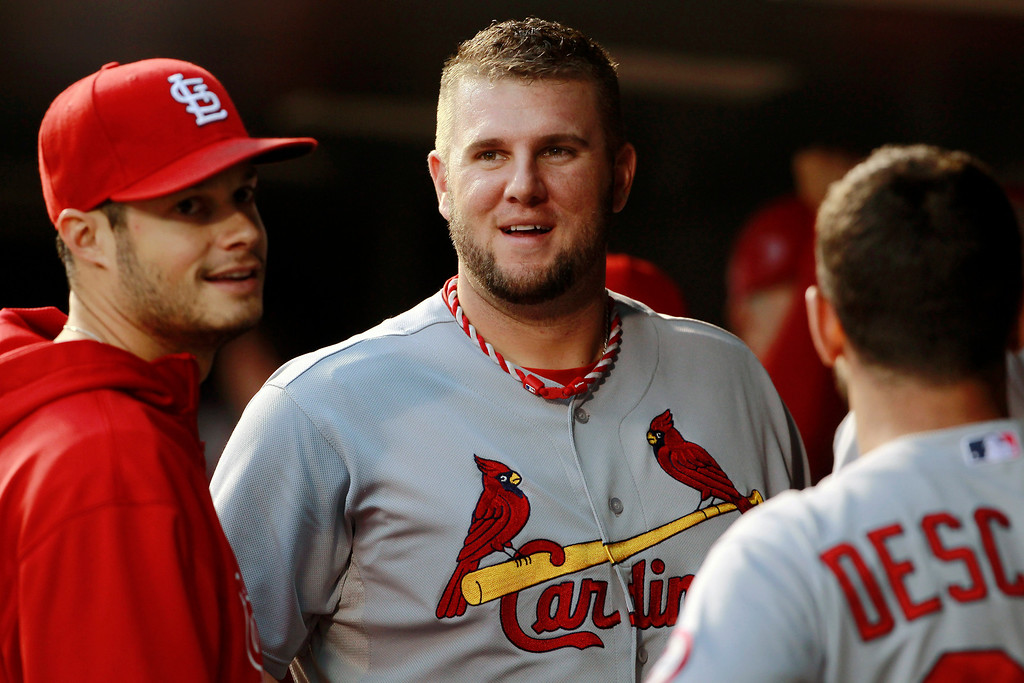 . St. Louis Cardinals first baseman Matt Adams, center, jokes with Joe Kelly, left, and Daniel Descalso before facing the Colorado Rockies in the first inning of a baseball game in Denver on Wednesday, Sept. 18, 2013. (AP Photo/David Zalubowski)