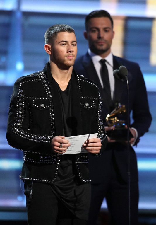 . Nick Jonas presents the award for best pop duo/group performance at the 59th annual Grammy Awards on Sunday, Feb. 12, 2017, in Los Angeles. (Photo by Matt Sayles/Invision/AP)
