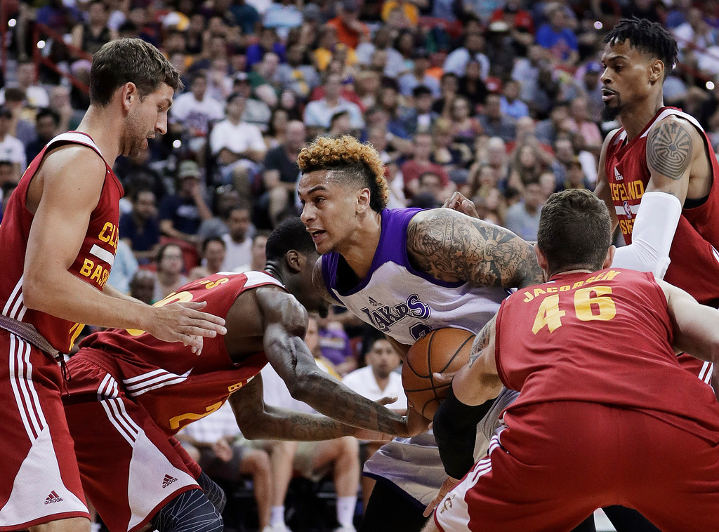 . Cleveland Cavaliers\' Michael Stockton, left, DeAndre Liggins, second from left, Eric Jacobsen, second from right, and Raphiael Putney, right, vie for the ball with Los Angeles Lakers\' Zach Auguste during the first half of an NBA summer league basketball game Thursday, July 14, 2016, in Las Vegas. (AP Photo/John Locher)