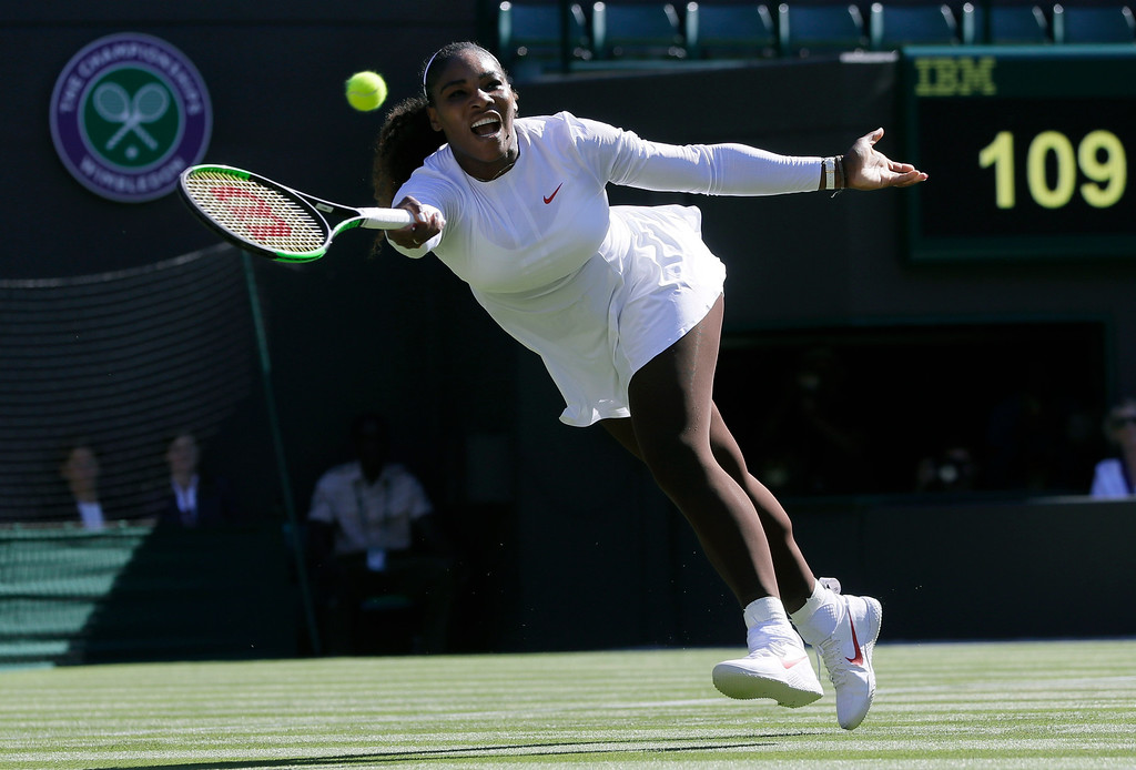 . Serena Williams of the US plays a return to Arantxa Rus of the Netherlands during the women\'s singles first round match at the Wimbledon Tennis Championships in London, Monday July 2, 2018. (AP Photo/Kirsty Wigglesworth)