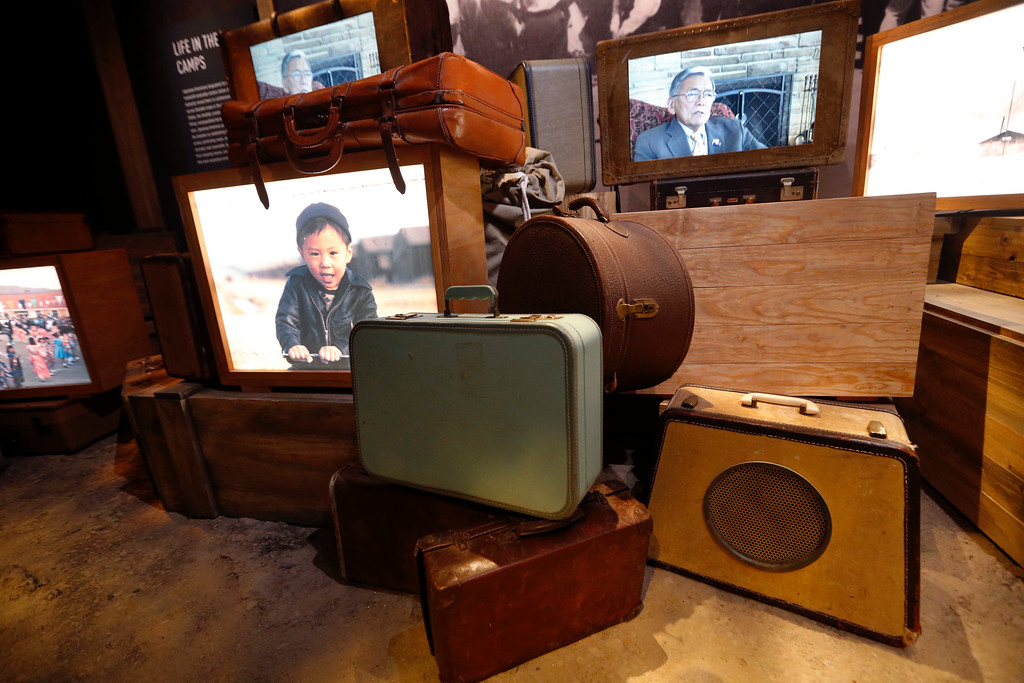 ". Luggage, an image of a boy of Japanese descent, and a video interview of a man who was kept in an internment camp, are part of the permanent exhibit ""Salute to the Home Front\"" at the National World War II Museum which will open to the public this Saturday, in New Orleans, Monday, June 5, 2017. The exhibit tells the home front story from the 1920s to the development of the atomic bomb. (AP Photo/Gerald Herbert)"