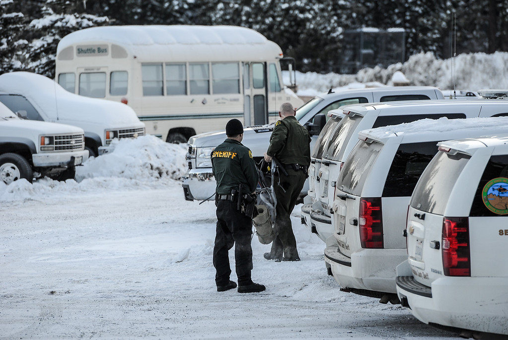 . A sheriff\'s deputy waits for his partners as they prepare to leave the command post at Bear Mountain Resort at start of day four in the search for fugitive ex-cop Christopher Dorner in Big Bear on Sunday, Feb. 10, 2013. (Rachel Luna / Staff Photographer)