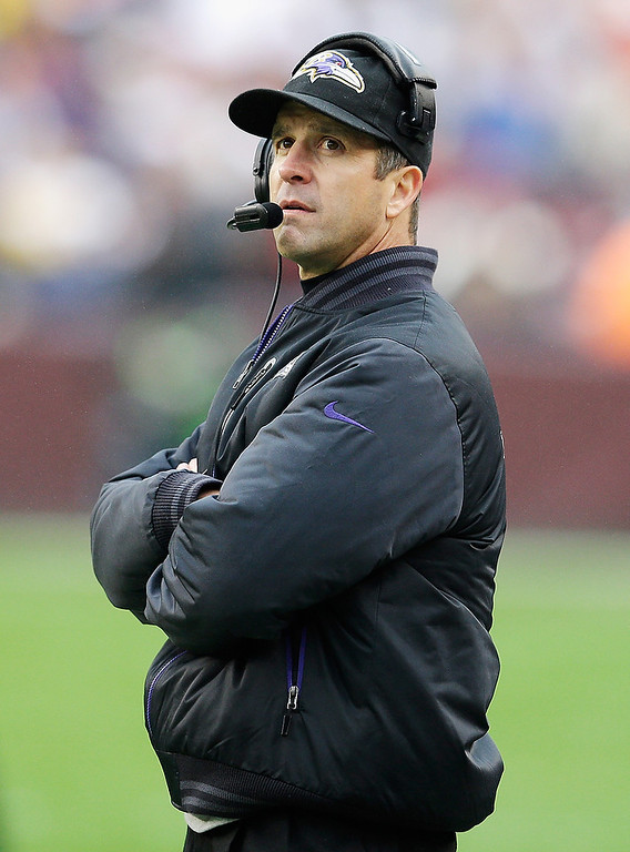 . LANDOVER, MD - DECEMBER 09:  Head coach John Harbaugh of the Baltimore Ravens looks on from the sidelines during the second half of the Ravens 31-28 overtime loss to the Washington Redskins at FedExField on December 9, 2012 in Landover, Maryland.  (Photo by Rob Carr/Getty Images)