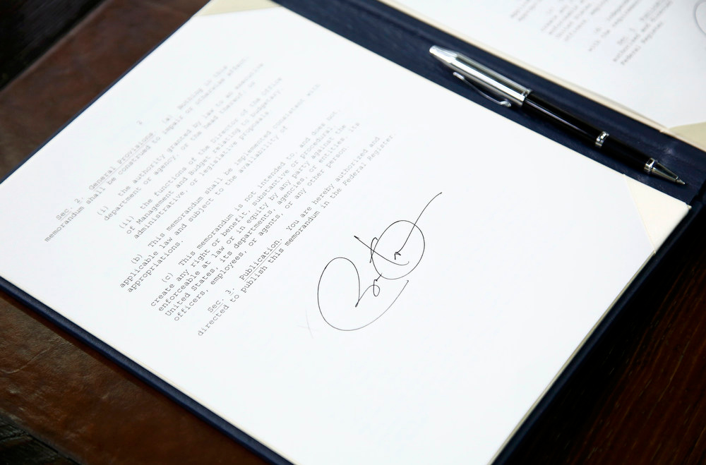 . U.S. President Barack Obama\'s siganture is seen on a set of executive orders that he signed prior to unveiling a series of proposals to counter gun violence, at the White House in Washington January 16, 2013.  REUTERS/Jason Reed