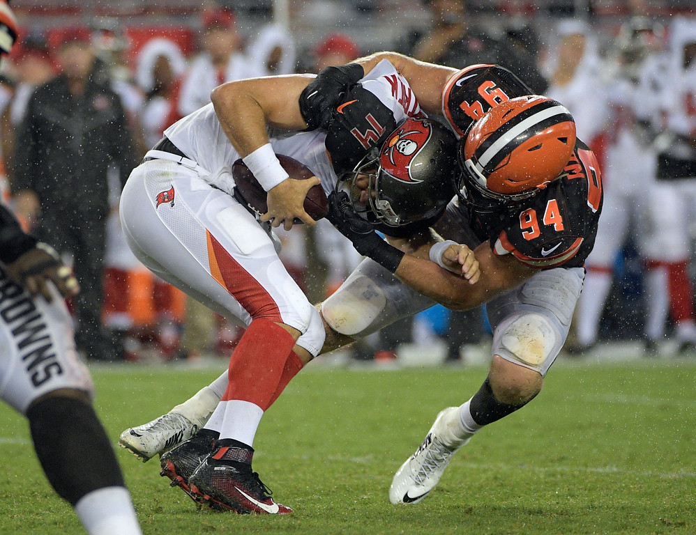 . Cleveland Browns defensive end Carl Nassib (94) sacks Tampa Bay Buccaneers quarterback Ryan Fitzpatrick (14) during the fourth quarter of an NFL preseason football game Saturday, Aug. 26, 2017, in Tampa, Fla. (AP Photo/Phelan Ebenhack)