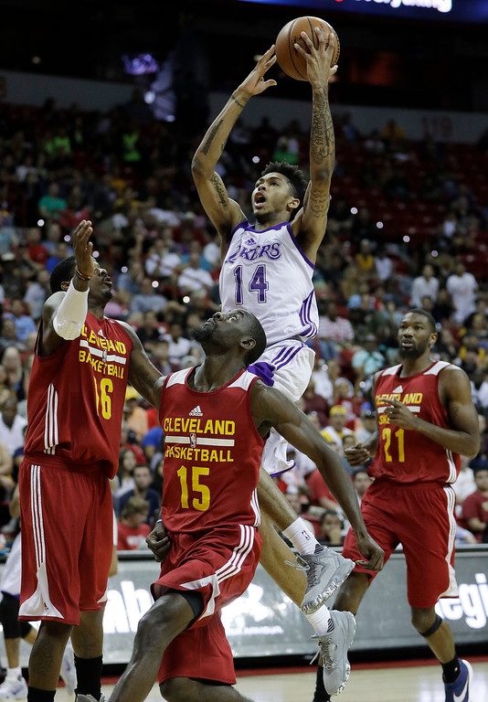 . Los Angeles Lakers\' Brandon Ingram shoots over Cleveland Cavaliers\' Kenny Gabriel, left, Sir\'Dominic Pointer, second from left, and Cory Jefferson during the first half of an NBA summer league basketball game, Thursday, July 14, 2016, in Las Vegas. (AP Photo/John Locher)