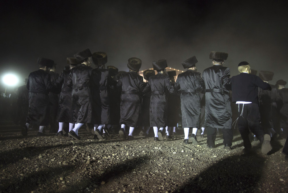 . Ultra-Orthodox Jews dance during the wedding of the great-grandson of the Rabbi of the Tzanz Ultra-Orthodox Hasidic community in Netanya, on January 2, 2013. MENAHEM KAHANA/AFP/Getty Images