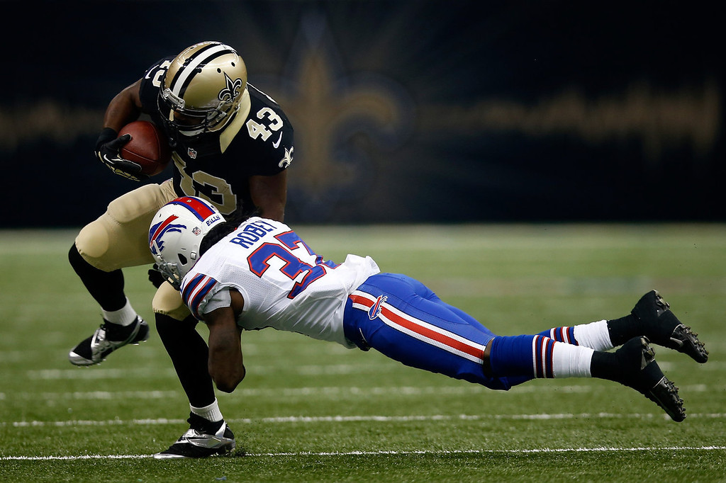 . Darren Sproles #43 of the New Orleans Saints is tackled by  Nickell Robey #37 of the Buffalo Bills at Mercedes-Benz Superdome on October 27, 2013 in New Orleans, Louisiana.  (Photo by Chris Graythen/Getty Images)