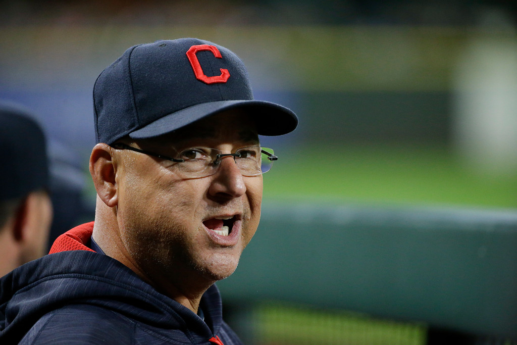 . Cleveland Indians manager Terry Francona looks toward the plate from the visitors\' dugout during a baseball game against the Seattle Mariners, Friday, Sept. 22, 2017, in Seattle. (AP Photo/Ted S. Warren)