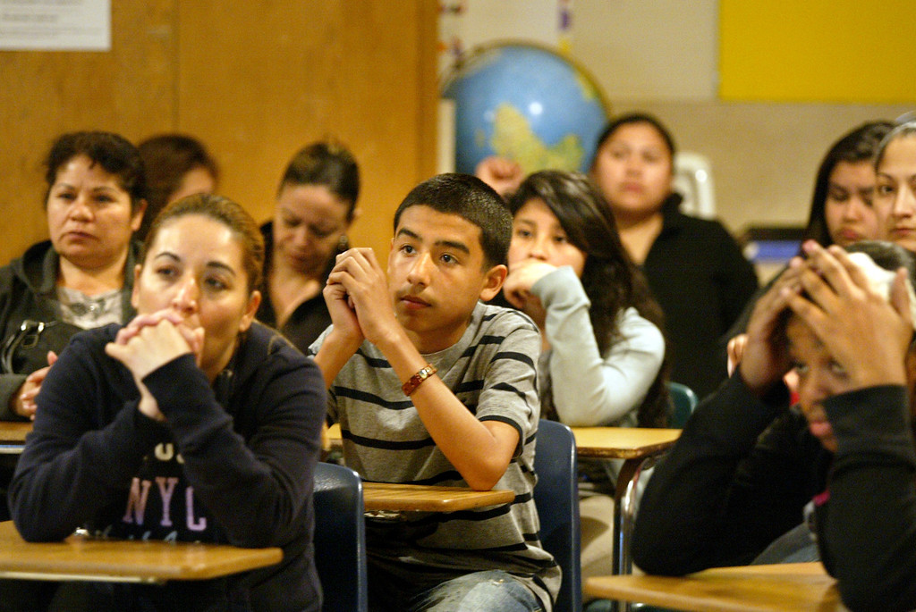 . Parents and children sit in classroom as they hope to hear the children\'s names called to be enrolled in Richmond Leadership Public High School through a lottery process in Richmond., Calif., on Thursday, Feb. 28, 2013.  The charter school registered 250 students but only 120 were accepted, including 50 of them because they have siblings currently enrolled.  (Ray Chavez/Staff)