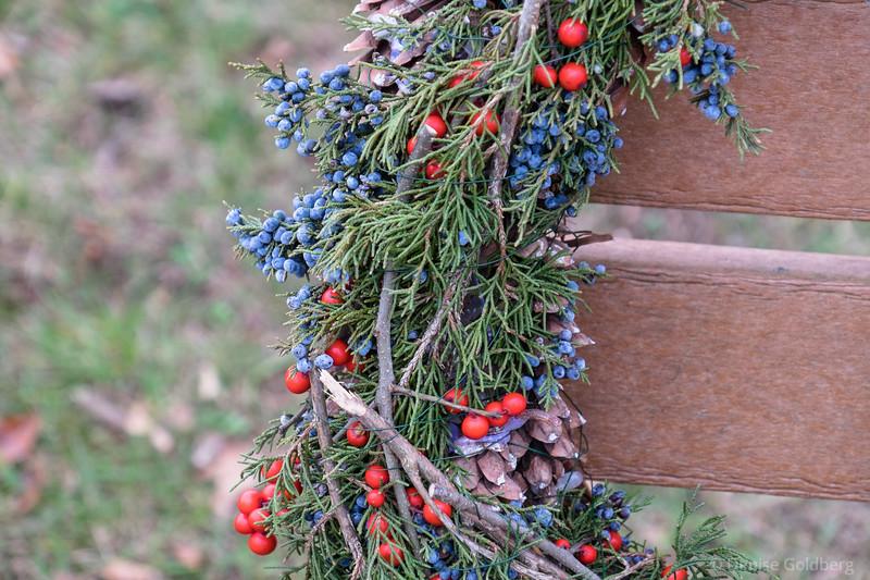 a wreath on a bench