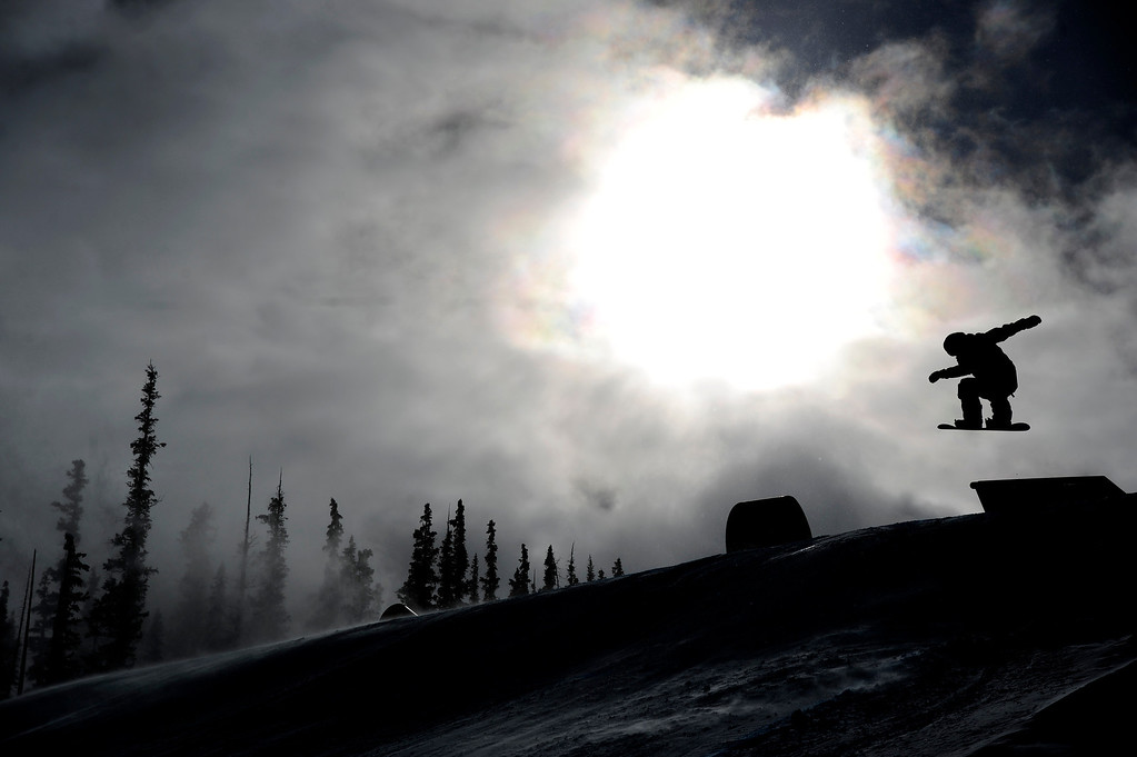 . Lucien Koch rides during the slopestyle finals of the Copper Mountain Grand Prix. Riders competed in this stage of the FIS Snowboard World Cup 2014 on Sunday, December 22, 2013. (Photo by AAron Ontiveroz/The Denver Post)