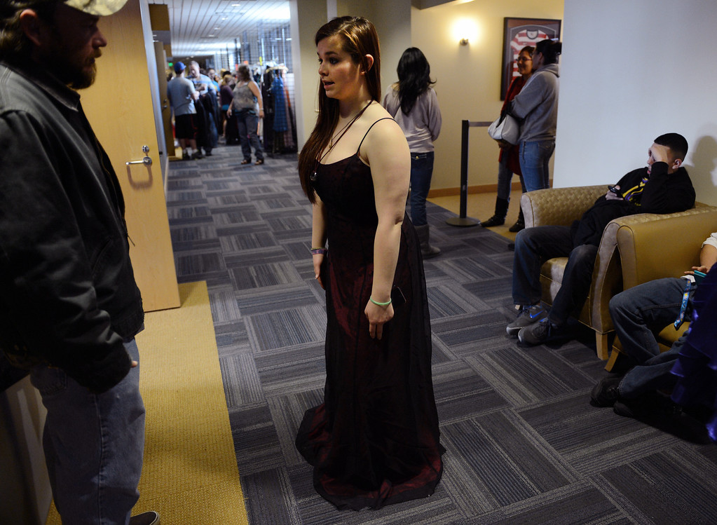 . COMMERCE CITY, CO. - MARCH 16:  Robin Durtante, a junior at Berthoud High School, talks with her father, Mike, while trying on dresses at the Prom Dress Exchange Corp. event in Commerce City, CO March 16, 2013. With a valid student ID and a suggested $10 donation, teenage girls could chose from 1,356 donated dresses that lined a long hallway at Dick�s Sporting Goods Park.  (Photo By Craig F. Walker/The Denver Post)