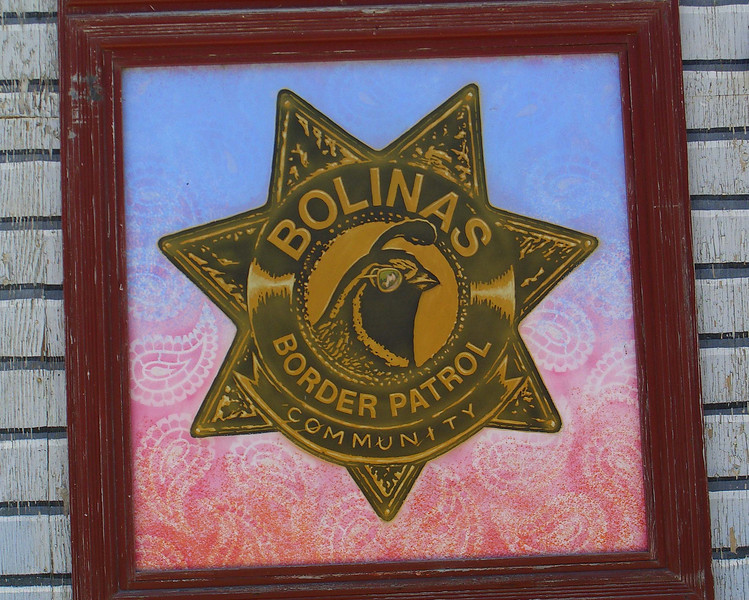 "This painted expression has nothing to do with the southern California/Mexican border and everything to do with keeping Bolinas a ""hidden"" community, and the community has a reputation for discouraging visitors.  The state stopped erecting directional signs to Bolinas because locals kept tearing them down."