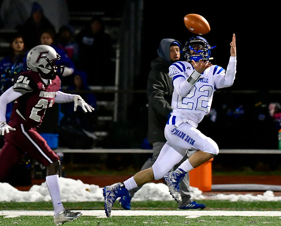 11/21/2018 Mike Orazzi | Staff Plainville's Brady Callahan (22) and Farmington's Clyde Wiafe (24) during Wednesday night's football game at Farmington High School.
