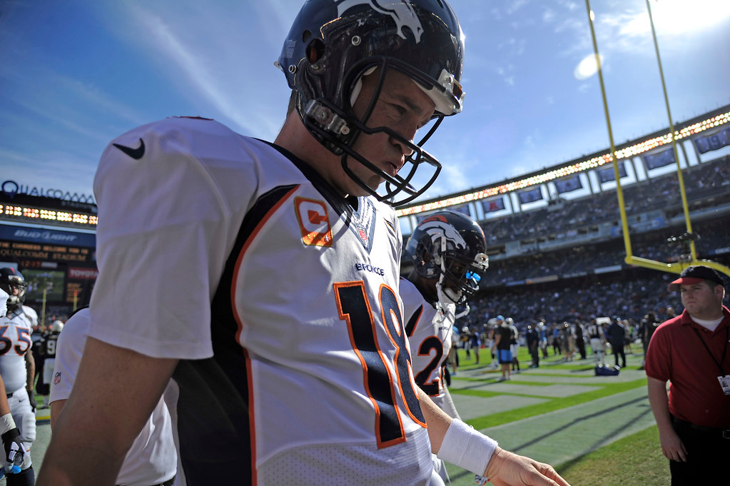 . SAN DIEGO, CA - DECEMBER 14: Denver Broncos quarterback Peyton Manning (18) walks off the field after pre game warm ups before the game against  the San Diego Chargers December 14, 2014 at Qualcomm Stadium \\. Manning wasn\'t feeling well during the game. (Photo By John Leyba/The Denver Post)