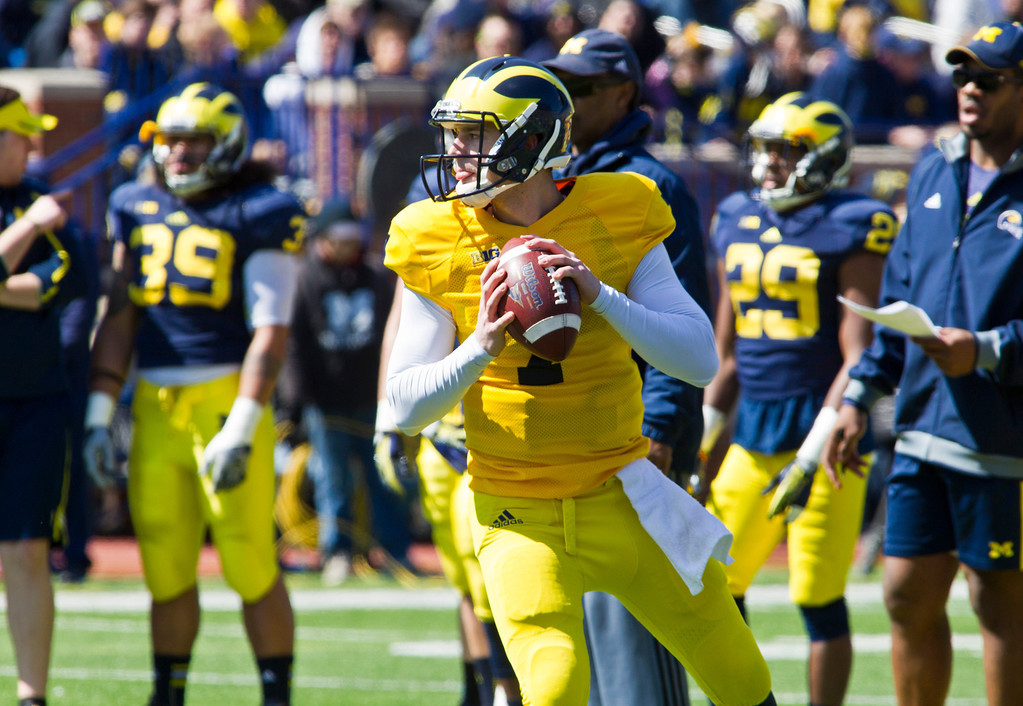 . Michigan quarterback Shane Morris (7) drops back to throw a pass during the football team\'s annual spring game, Saturday, April 5, 2014, in Ann Arbor, Mich. (AP Photo/Tony Ding)