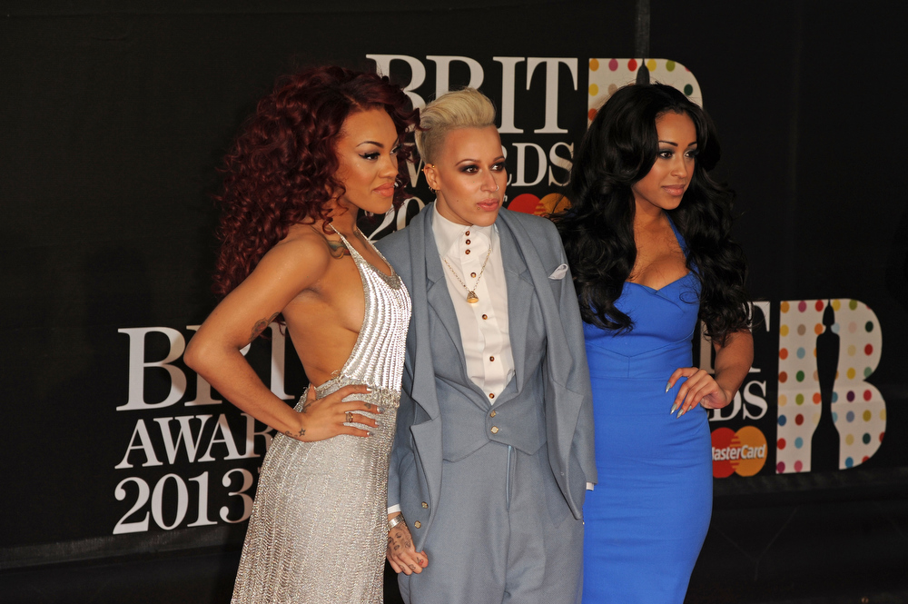 . Karis Anderson, Courtney Rumbold and Alex Buggs of Stooshe attend the Brit Awards 2013 at the 02 Arena on February 20, 2013 in London, England.  (Photo by Eamonn McCormack/Getty Images)